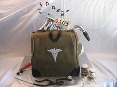Medical bag cake of The Day Nursing Articles, Medical Bag, Bag Cake, Cupcake Cookies, Cupcakes, Take The Cake, Edible Art, Red Cross, Muffin