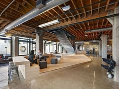 Heavybit Industries / IwamotoScott Architecture - I love how the platform continues up to form the bar seating on the left