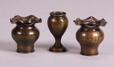 Pair of small Dirk van Erp hammered brass shell casing vases. Excellent new patina. 3.25″h x 3″dr; small Dirk van Erp hammered brass narrow shell casing. Excellent new patina. 3.5″h