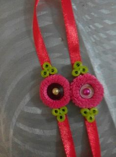 Handmade rakhi Hobbies And Crafts, Fun Crafts, Diy And Crafts, Paper Crafts, Handmade Rakhi Designs, Handmade Design, Quilling Jewelry, Quilling Paper Craft, Crochet Bib