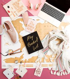 FOR THE GIRL WHO LOVES TO TRAVEL: 1. Breakups to Makeup Holiday Bag, SEPHORA, $26; 2. Rose Gold Headphones, BEBE, $49; 3. Gold 12-Inch MacBook, APPLE, $1,299; 4. Rose Gold Glitter Textile Slip-Ons, VANS, $60; 5. Why Hello There Mirrored iPhone 6 Case, KATE SPADE NEW YORK, $40; 6. The Getaway Passport Holder, BAN.DO (Available at Dormify), $24; 7. Mighty Mini Downtown Styler, AMIKA (Available at Sephora), $29; — see the rest on Cosmopolitan.com!