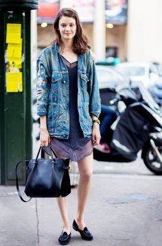 A light silk dress with a distressed denim jacket and slip-ons