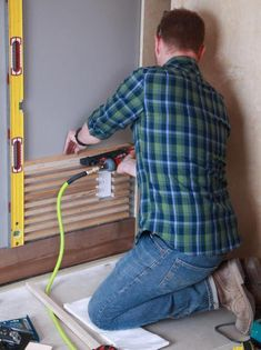 How to Design a Wood Slat Wall Dress up a room with a custom, budget-friendly wooden wall treatment.<br> Dress up a room with a custom, budget-friendly wooden wall treatment. Wood Slat Ceiling, Wood Slat Wall, Wood Panel Walls, Wooden Slats, Wooden Diy, Wood Paneling, Timber Slats, Timber Cladding, Stripped Wall