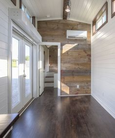 Barn wood accent walls in the living room and bedroom add a rustic element to tie in with the exterior.