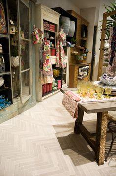 Anthropologie at Regent Street, London. Stone floor tiles in a herringbone pattern - love them!