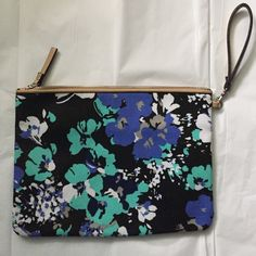 Large wristlet pouch! Large 11.5x8.5 inches! Excellent condition! Great to carry with or without the wristlet! Wristlet or clutch! Great to put in a travel bag too! Beautiful floral deign! With black, blue and mint colors! Zipper closure and zipper compartment on the inside! Merona Bags Clutches & Wristlets