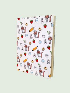 Jot down your recipes or restaurant reviews in this cute notebook featuring Chef Kitty and his assistant, Le Cordon Bleu Hamster.    Original