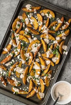 These simple Roasted Potato Wedges are the perfect vehicle for this creamy garlicky shawarma sauce and crumbled feta. Vegetable Side Dishes, Vegetable Recipes, Vegetarian Recipes, Cooking Recipes, Healthy Recipes, Budget Recipes, Easy Roasted Potatoes, Roasted Potato Wedges, Shawarma Sauce