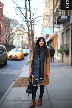 The Central Steppes -  - Cozy-chic winter warmth in nolita | camel coat | blanket scarf | cognac ankle booties from nordstrom | topshop moto baxter jeans | balenciaga classic work bag | nolita nyc | soho holiday shopping | mott street | gimme coffee | neutrals | ootd