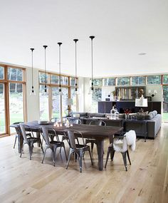 Gray metal chairs add style to a modern family dining room