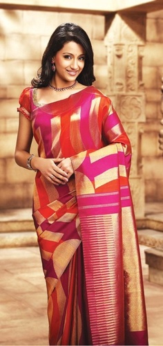 A delightful silk saree. Just the yummy colours are enough, the silk doesn't really need much else! --- #indian #wedding #trisha