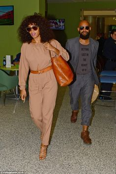 Honeymooning: Solange and Alan head off through the Miami airport to continue along on the...