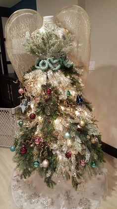 30e1289e1b28e Dress Form Christmas Trees · My non-traditional Christmas tree this year!  Left over angel wings from Halloween,