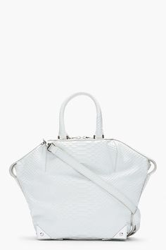 Alexander Wang Glacier White Python Leather Emile Tote -  Alexander Wang Glacier White Python Leather Emile Tote Alexander Wang Structured leather tote in white with embossed pythonskin texture throughout. Silver tone hardware. Single adjustable removable shoulder strap with lanyard clasps at top. Two rolled carry handles. Two_way zip closure at main...