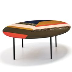 The Fishbone tables are designed by Patricia Urquiola for Moroso. The tops are made with a unique acrylic manufactured by Sintetica, an acrylics specialist based in Italy.  The acrylic panels in different colours are bonded together with a smooth, glossy finish and are arranged in a highly graphic design which showcases the vibrancy of the material. The Fishbone tables work well as occasional tables for both private and public spaces and are great for injecting colour into any design scheme.