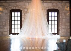 To hang from pergola- light peach and ivory tulle with extra lights.