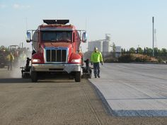 A truck that puts down the tack coat and fabric at the same time during paving operation in West Sacramento, Calif.