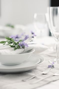 white table setting with fresh flowers
