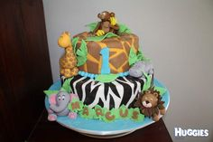 We had a jungle themed party for my sons first birthday so I wanted to make a cake that matched. I googled jungle cakes but didnt find anything I 100% loved so put a few different ideas together and this is what I came up with. Making the little animals out of fondant was so much fun!! I made 2 different flavoured mudcakes a cherryripe one (which was delicious), and a white choc mud. It turned out great! I was so happy with it. It tasted fantastic too!
