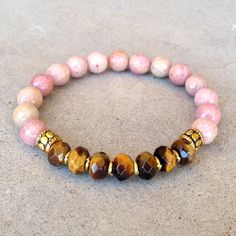 Beautiful bracelet made with rhodochrosite and hand cut tiger´s eye gemstones, with tiny African trade beads for detail, perfect for layering with other bracelets. Rhodochrosite is a stone for emotion