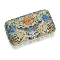 A silver-gilt and champlevé enamel cigarette case, Khlebnikov, Moscow, 1883 the surface with shaded polychrome flowers, butterflies and fret patterns within engraved and stippled foliage, 88 standard width: 16.3cm, 4 1/8