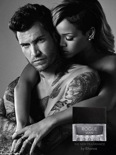 Rihanna strikes a steamy pose with a male model in promotional shots for her new fragrance Rogue Man