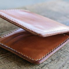 For the past two weeks,I've been working on a new line of wallets including a new travel/field notes wallet, a medium sized 7 pocket bifold and a full size 9 pocket bifold, a small new card wallet and a new passport/trucker wallet.  We're pumped and can't wait to share everything with y'all! It was nice dusting off my wallet skills for a change. This piece was totally hand made, from the cuts to the punching to the stitching and edging. I'm ecstatic about the things we've been working on…