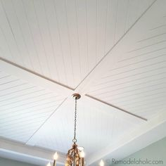 DIY Plank Ceiling in a Beautiful White Kitchen Renovation beautiful diagonal planked shiplap ceiling design via Remodelaholic Shiplap Ceiling, Porch Ceiling, Home Ceiling, Bedroom Ceiling, Ceiling Panels, Ceiling Decor, Ceiling Beams, Low Ceilings, Living Room Ceiling Ideas