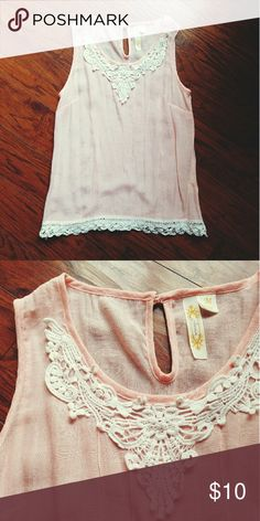 Light pink tank top Very cute tank with white lacey embroidery on top and bottom. Comfortable light material and in great condition. 60% rayon, 40% polyester. Adiva Tops Tank Tops