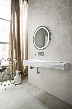 ... round mirror works well on bare concrete wall