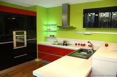 #Kitchen of the Day: Modern Red Kitchen with black cabinets and green walls.