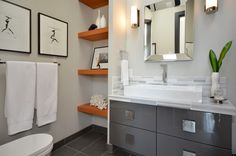Wood shelves, grey vanity in the bathroom.