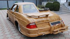 Half retro and half modern, this very unusual wooden car created by Vasily Lazarenko is made of a refashioned chassis and engine from a 1981 Opel with a whole lot of wood for the exterior.