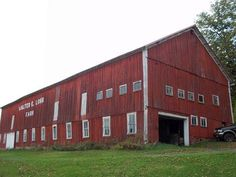 Front of Barn:                       SOLD!   The red barn is 40 ft wide by 115 ft long. It has a metal roof that is only 3 years old. The metal sheets are 25 ft long