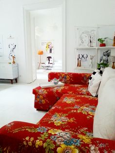 This stunning red floral sofa looks amazing in a neutral white apartment. Decor, Room, Interior, Home, Floral Sofa, House Interior, Home Deco, Interior Design, Home And Living