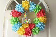 This is a quick and cool idea for a festive wreath...you could do appropriate colored bows based on the occasion! Very smart =)