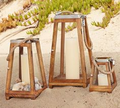 Due to their slight pyramid shape, these wooden lanterns ($31-$103) are in no danger of blowing over. — Outdoor Lantern Roundup