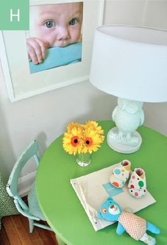 Love the little table and white frames with close up pics of the little one!