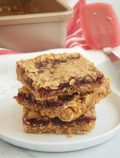 These super simple Oatmeal Raspberry Bars are always such a hit. I love that I always have everything in my kitchen to make these! - Bake or Break