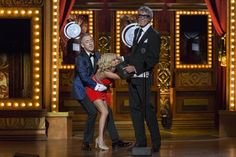 Hosts Alan Cumming and Kristin Chenoweth joke with actor Tommy Tune as he takes the stage to present the Best Direction of a Musical award. Tommy Tune received the Lifetime Achievement Award earlier during the show. REUTERS/Lucas Jackson