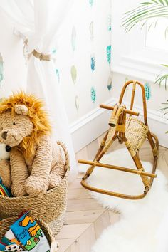 Nursery with a rattan rocking horse and toys