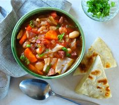 French-style Ham, Bean and Cabbage Soup Hearty soup, rich with ham, cabbage and beans, served with wedges of easy to make flatbread. Cabbage Rolls, Cabbage Soup, Ham And Beans, Dinner Rolls Recipe, Ham Soup, Leftover Ham, Flat Bread, Cabbage Recipes, Lentil Soup