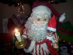 Hugging Santa and telling him who was good or bad!