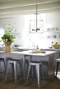 A Modern Farmhouse | Garden and Gun fun link: nice long side of the room kitchen island table action and open shelves on top