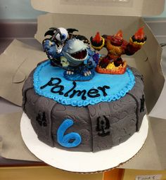 Skylanders cake for KB - you can totally pull this off....circle cake and buy a new skylander as a topper!  DONE! lol!
