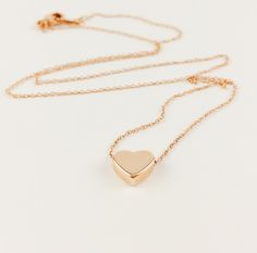 Gorgeous rose gold plated, dainty heart on a very thin and tiny chain.  Perfect for the lady that likes nothing more then the minimal style.