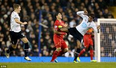 Paulinho (right) was sent off against Liverpool in December 2013 for this tackle…