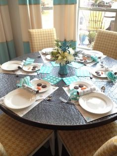 Our breakfast nook table all set for the kids' table for #Christmas Day dinner. #tablescape #snowman