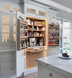 Do you love this kitchen and pantry as much as I do? The neutral white is classy and beautiful. Seriously gorgeous! You will love all of these kitchens! #gorgeouskitchen #kitchengoals #whitekitchen #farmhousekitchen #neutralkitchen #whitefarmhouse #pantry #rustickitchen #rustichomedecor #kitchen