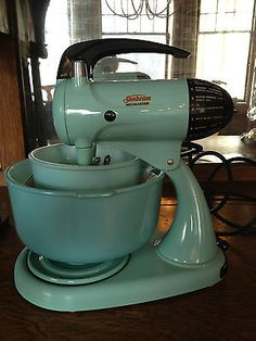 Vintage aqua / turquoise blue sunbeam mixmaster mixer with two matching bowls